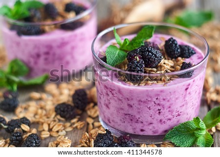 Mulberry smothie with homemade granola copy space background - stock photo