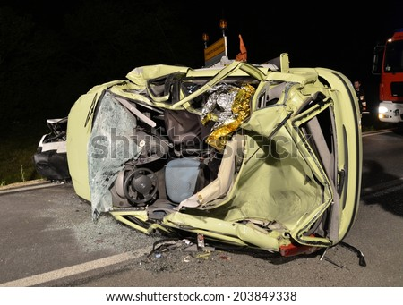 MULES, ITALY - JUNE 16, 2014: Terrible car crash collision in the night with tree cars and one truck  on June 16, 2014 - stock photo