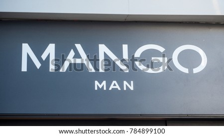 Mulhouse France - 31 December 2017 - retail of Mango sign in mango store for man entry