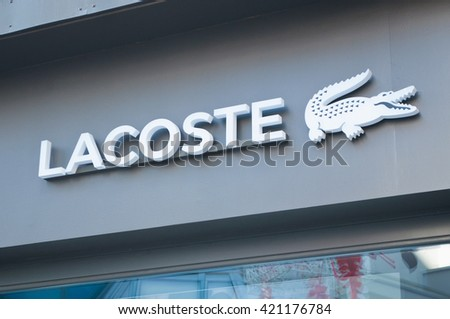 "MULHOUSE - France 15 May 2016 - retail of the Crocodile shaped logo of the brand ""Lacoste"" the french brand of sportwear signage"