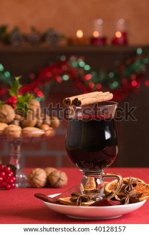 Mulled red wine at Christmas with selection of nuts in background - stock photo
