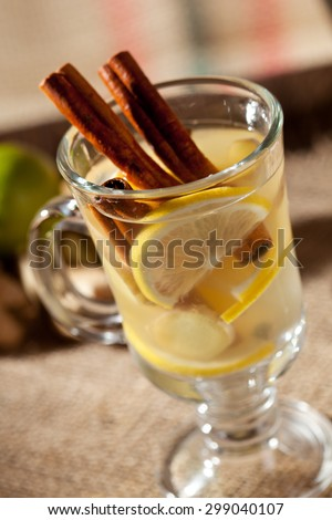Mulled White Wine Cocktail with Cinnamon Sticks