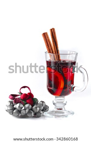 Mulled wine and Christmas ornament isolated on white, shallow focus - stock photo