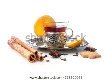 Mulled wine, Christmas punch with orange slices and spices like cinnamon, star anise and cloves isolated with shadows on a white background - stock photo
