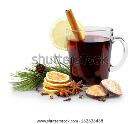 Mulled wine in glass with cinnamon stick, christmas sweets, isolated - stock photo