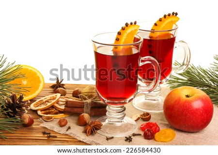 Mulled wine in two glasses on a wooden table on a white background