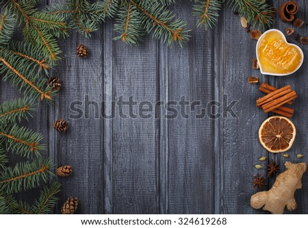 Mulled wine,ingredients.Christmas or winter warming drink. Honey, orange, cinnamon sticks, cloves ,ginger,cardamom and sugar.Copy space.selective focus - stock photo