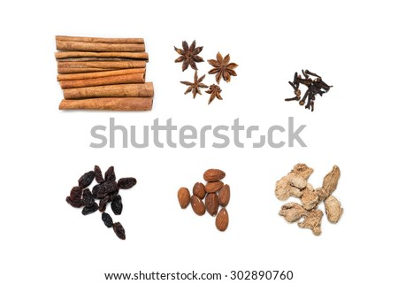 Mulled wine ingredients (cinnamon, anise, raisins, ginger, cloves) isolated on white, top view. - stock photo