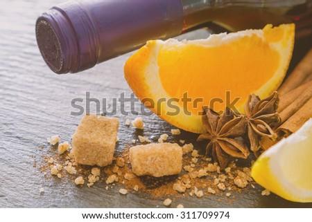Mulled wine ingredients on dark stone background, toned - stock photo