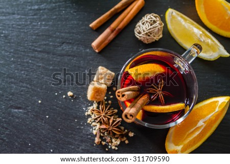 Mulled wine ingredients on dark stone background, top view - stock photo