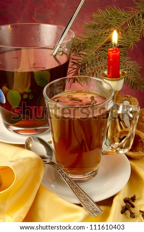 mulled wine with a spoon on intimate background