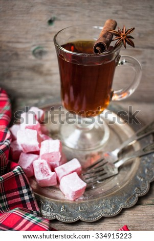 Mulled wine with cinnamon and anise star and turkish sweets