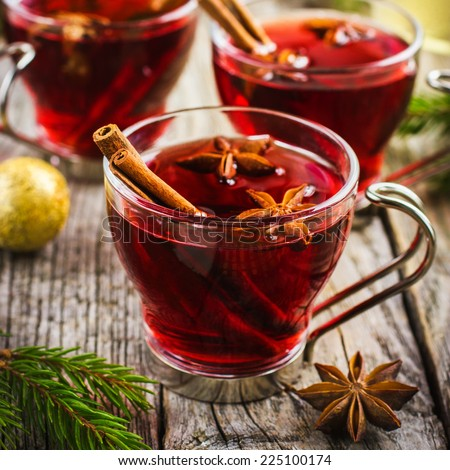 Mulled wine with cinnamon and anise stars, square image - stock photo