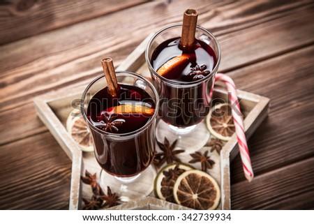 Mulled wine with cinnamon sticks and orange - stock photo