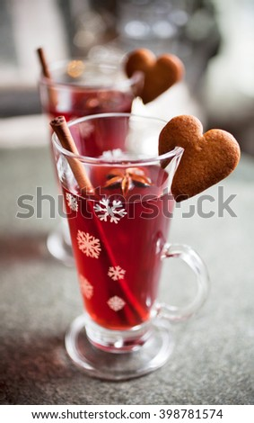 Mulled wine with heart shape gingerbread cookies - stock photo