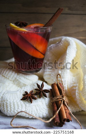 Mulled wine with spices on wooden background - stock photo