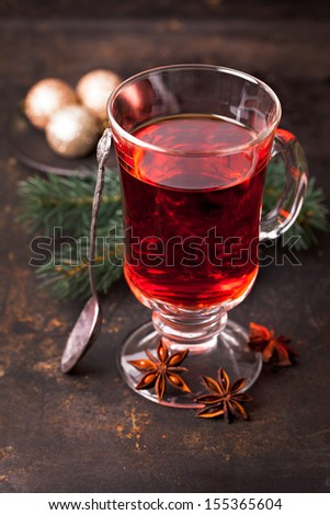 mulled wine with spoon and anise  - stock photo