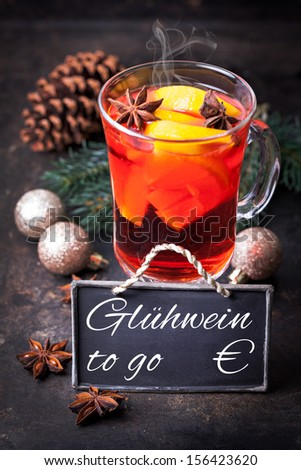 mulled wine with tag and german text Gluehwein to go - stock photo
