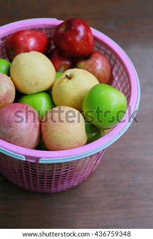 multi color apple in basket - stock photo