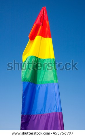 Multi color banner and blue sky.