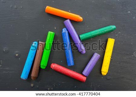 multi color chalk Oil pastel on black background - stock photo