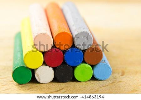 multi color chalk Oil pastel on wooden desk - stock photo