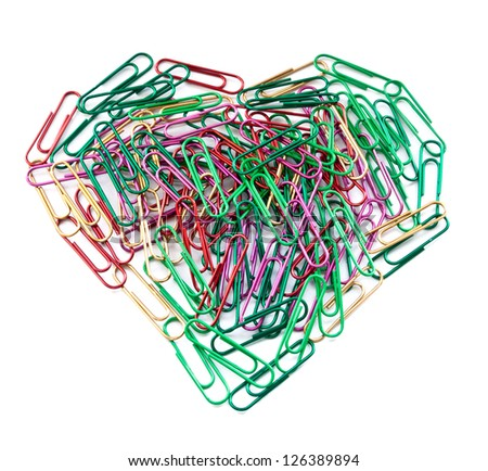 Multi color paper clips arranged in heart shape isolated on white. - stock photo