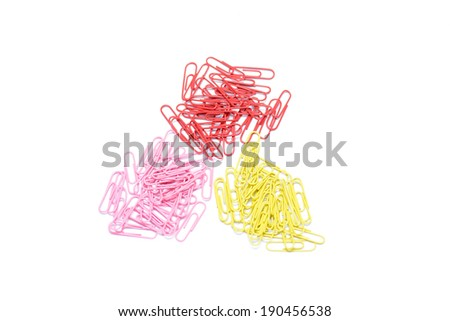 Multi color paper clips arranged on isolated white background. - stock photo
