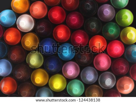 Multi color pastel(crayon) pencils for children(kids) used for drawing & coloring arranged attractively in rows and columns making a stunning display of colors - stock photo