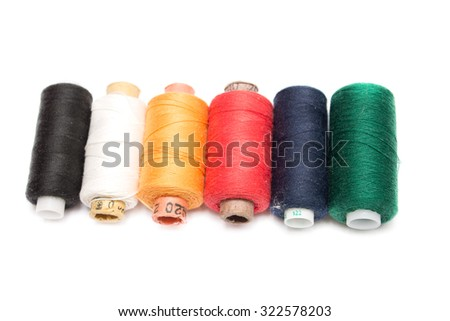Multi color sewing threads isolated on white background