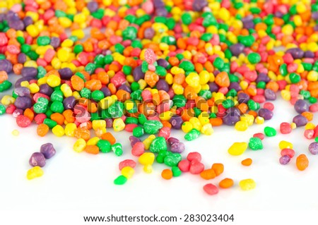 Multi color sugar dragee candies. Selective focus, main focus on the center. Copy space. Can be used as a background or header - stock photo