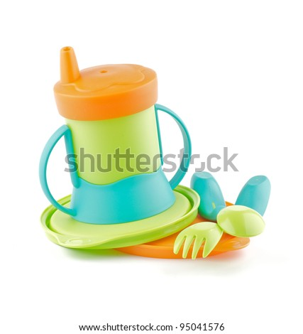 Multi-Colored Baby Bottle and Baby utensil isolated on white background - stock photo