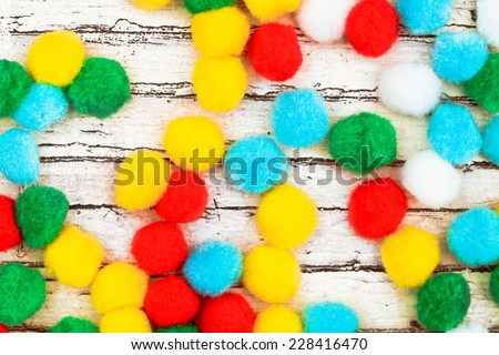 Multi-colored bonbons on a wooden surface as a background image - stock photo