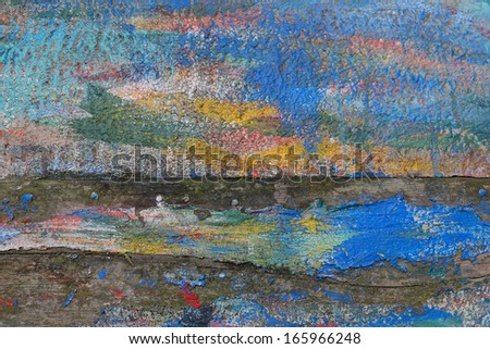 Multi-colored brush strokes on the hull of an old row boat  - stock photo