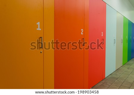 Multi-colored cabinets in the colors of the rainbow.  The cabinets are numbered from one to eight.