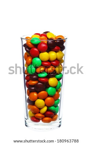 multi colored caramel sweets and chocolate candies in glass isolated on a white background - stock photo