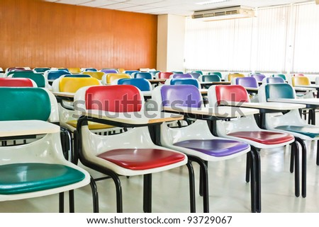 Multi-colored chairs arranged in the room