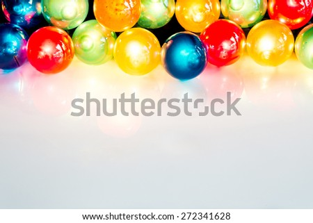 multi-colored Christmas light bulbs on white background - stock photo