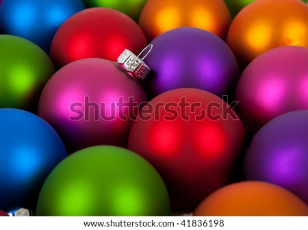 Multi-colored Christmas ornaments/baubles including pink, red, orange, blue, purple and green as a background