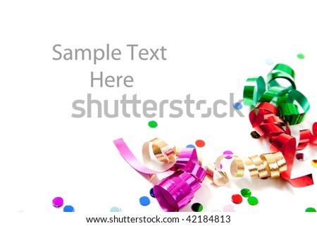 Multi-colored confetti and streamers including gold, red, green and purple on a white background with copy space - stock photo