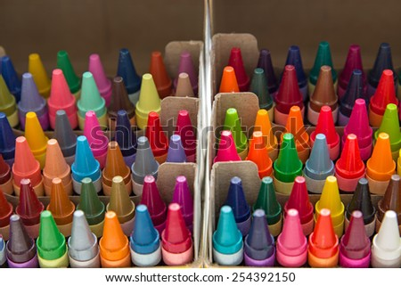 Multi colored crayons in a box - stock photo