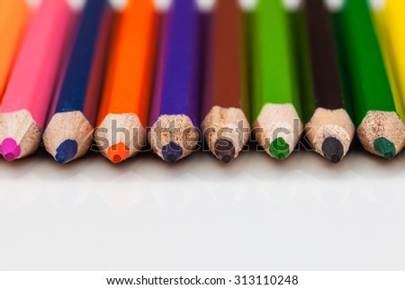 Multi Colored crayons on a white background. - stock photo