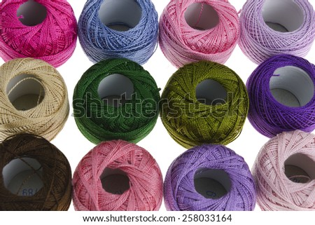 Multi-colored embroidery floss isolated on a white background. - stock photo