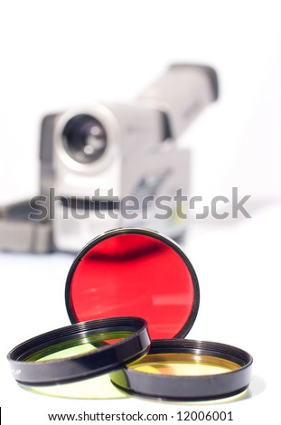 Multi-colored filters and a camcorder on the background