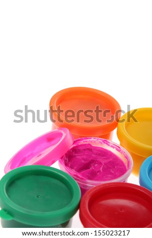 Multi-colored finger paints on white background