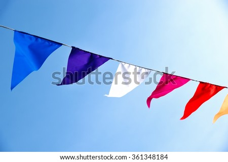 Multi-colored flags fluttering in the sky
