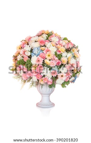 Multi-colored flowers in a vase White background,rose,gerbera.
