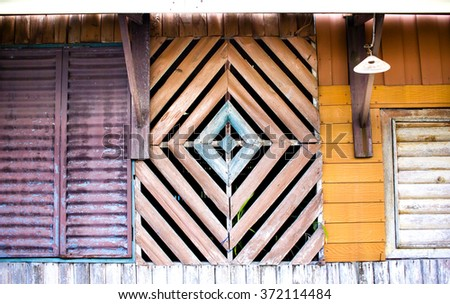 Multi-colored, geometrically shaped architectural detail, part of the house wall in the fisherman's village in Koh Kood island, Thailande. - stock photo