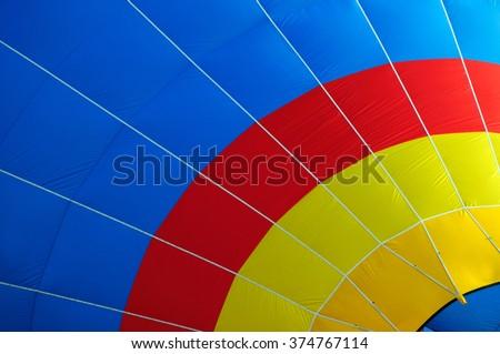Multi colored hot air balloon - stock photo