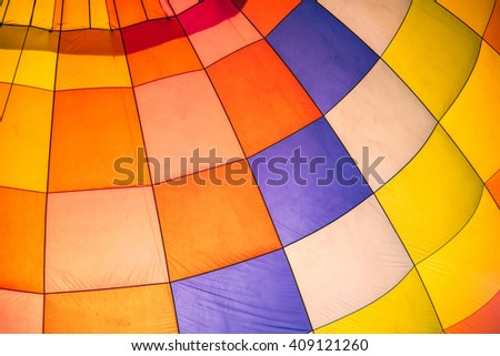 Multi colored hot air balloon. - stock photo